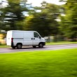 Delivery van moves on road — Stock Photo #67063535