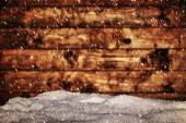 Wood board and mound of snow. — Stock Photo