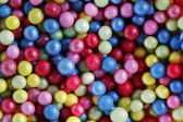 Colorful sweet sugar pearls — Stock Photo