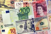 Mix of currencies banknotes — Stock Photo