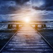 Old wooden jetty during storm — Stock Photo #65445975