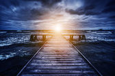 Old wooden jetty during storm — Stock Photo
