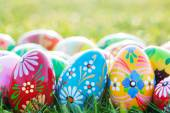 Hand-painted Easter eggs on grass. — Stock Photo