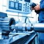 Man operating CNC drilling — Stock Photo #73925465