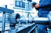 Man operating CNC drilling — Stock Photo