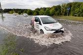 Car trying to drive against flood — Stock Photo
