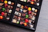 Pralines in gift box — Stock Photo
