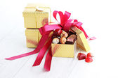 Box of chocolates with red ribbon — Stock Photo