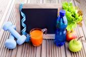Fitness frame with dumbbells and fruits — Stock Photo