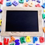 Wooden alphabet blocks as a frame — Stock Photo #69220961