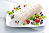 Delicious Swiss roll meringue with fruits — Stock Photo