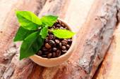 Bowl full of coffee beans — Stock Photo