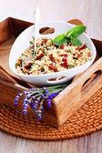 Bowl of bulgur salad  with dry tomato — Stock Photo