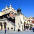 KRAKOW, POLAND - APRIL 10, 2015: Sukiennice in historical center — Stock Photo #71696715