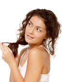 Girl plays with hair — Stock Photo