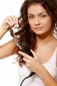 Girl doing hair perm — Stock Photo