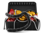 Black basket with christmas decorations isolated on white backgr — Stock Photo