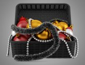 Black basket with christmas decorations isolated on gray backgro — 图库照片