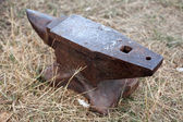 Old blacksmith anvil standing on the ground — Stock Photo