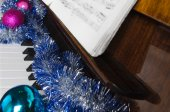 Attributes of celebration of New year and Christmas lie on a piano — Zdjęcie stockowe