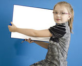 The girl shows a white plastic board — Stock Photo