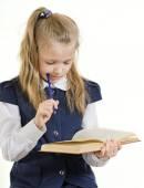 The schoolgirl reads the book — Stock Photo