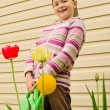 The young girl with a watering can — Stock Photo #73016743