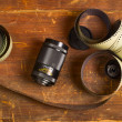 Old film for the camera and a lens — Stockfoto #76742379