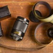Old film for the camera, a lens and flashlight — Stockfoto #76742389