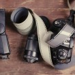 Old film for the camera, a lens, flashlight and the camera — Stockfoto #76742669