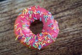 Donut with icing sprinkles — Stock Photo