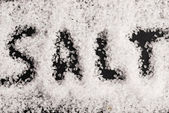 The word salt written into a pile of white granulated salt — Stock Photo