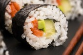 Salmon rolls served on a plate — Stock Photo