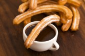 Deliciuos spanish Churros with hot chocolate — Stock Photo