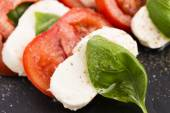 Caprese salad with mozzarella, tomato, basil and balsamic vinega — Stock Photo