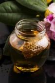 Fresh honey with honeycomb — Stock Photo