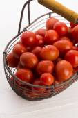 Cherry tomatoes in basket — Stock Photo
