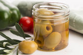 Pickled olives and olive tree branch — Stock Photo