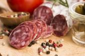 Slices of spanish pork sausage — Stock Photo