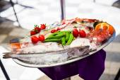 Fresh fish stored on the tray — Foto Stock