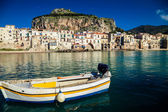 Old boat drifting in a Cefalu harbor — Stock Photo