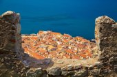 Cefalu old houses through the bastion's wall — Stock Photo