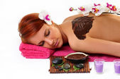 Woman enjoying a chocolate beauty treatment at the health spa — Foto de Stock