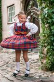 The dancing girl in latvian traditional suit — Stock Photo