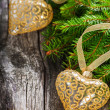 Spruce branches decorated golden hearts — Stock Photo #56210685