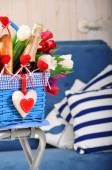 Basket with flowers and  champagne — Stock Photo