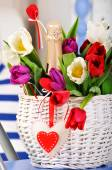 Basket with flowers and  champagne — Stok fotoğraf