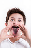 Boy showing tongue — Stock Photo