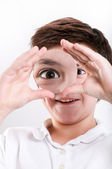 Boy looks at through a magnifying glass — Stock Photo