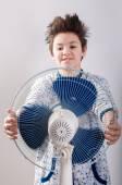 Boy near the ventilator — Stock Photo